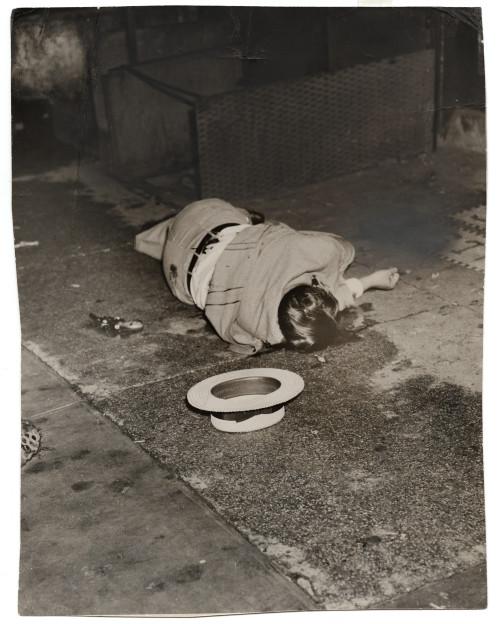 Weegee [Body of Dominick Didato, Elizabeth Street, New York], August 7, 1936 Gelatin silver print © Weegee/International Center of Photography International Center of Photography