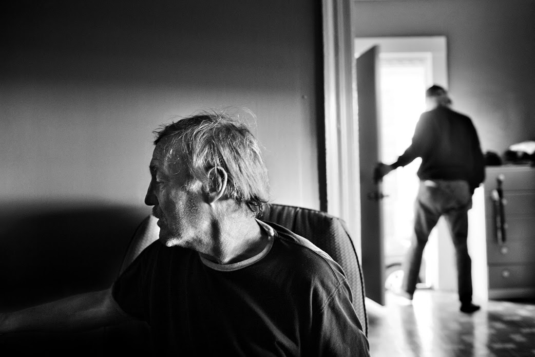 Paolo Pellegrin, Homeless men recently evicted from a tent city under the disused Rochester subway live temporarily in an apartment in the Crescent area of the city. Rochester, NY. USA 2012