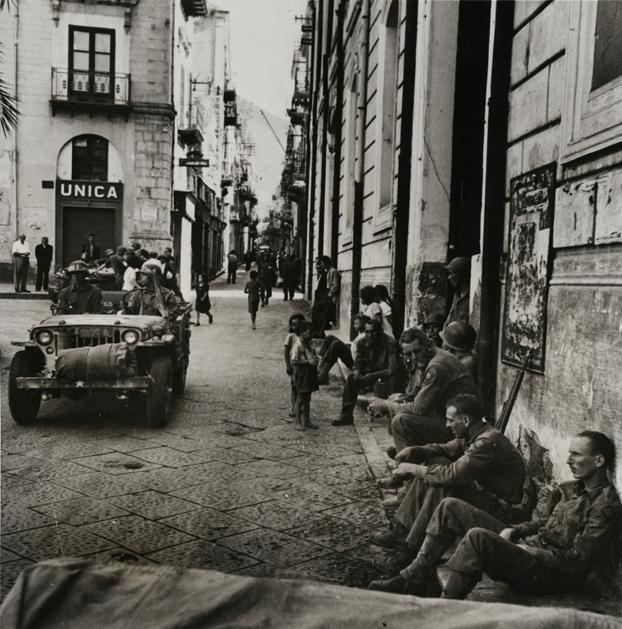 """Conquered Town, Cefalu, Sicily"", Robert Capa (1913-1954) july 26, 1943 silver gelatin print on glossy fibre paper, printed by August 23, 1943 17,4 (18,5) x 17 (18,1) cm Robert Capa © ICP / Magnum Photos, Courtesy: Galerie Daniel Blau Munich/London"