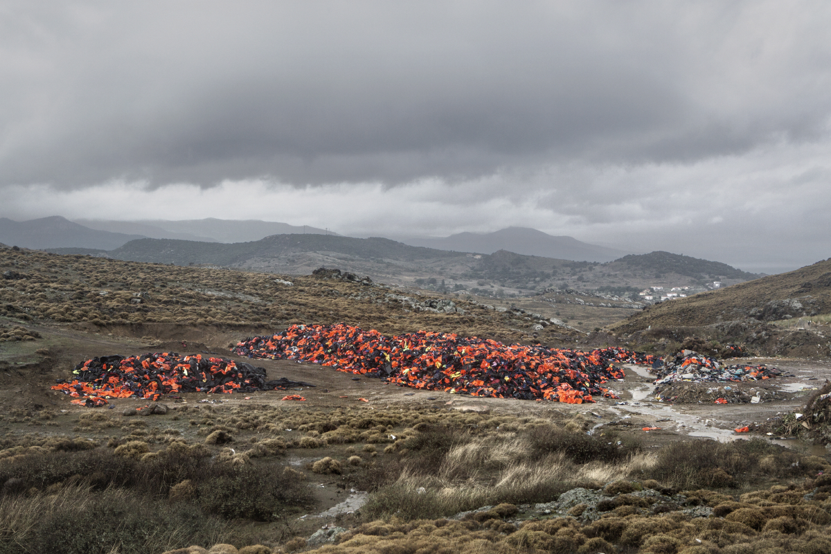 Molyvos, Lesvos, Oct. 23, 2015. A garbage dump near the town of Molyvos with thousands of discarded life jackets, used by refugees and migrants during their journey to Europe. © Alessandro Penso