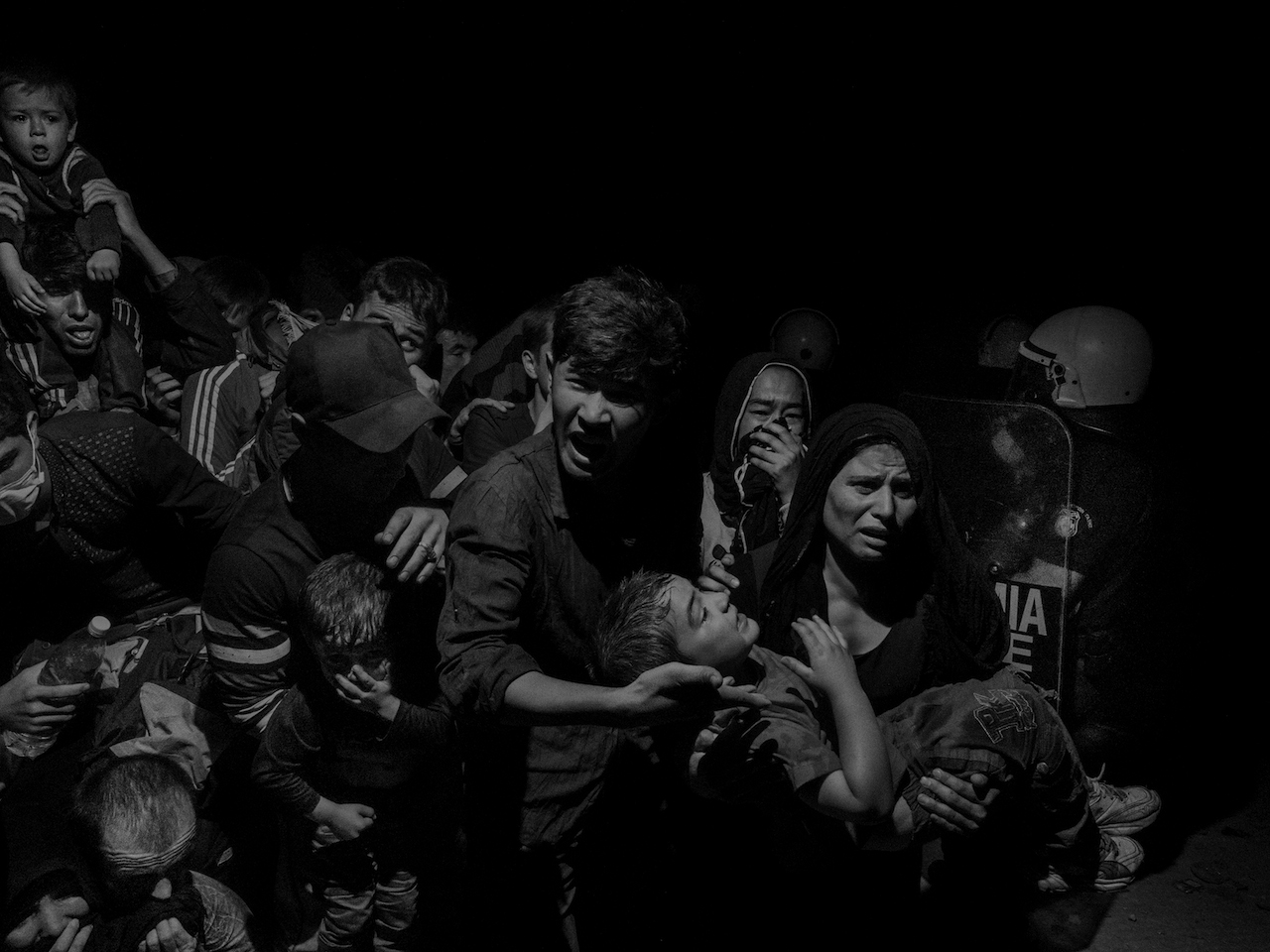 Alex Majoli. Greece, Lesbos. 2015. The refugees and migrant arriving on Lesbos island are transferred to Moria refugee camp where they await registration from authorities before they can move on.