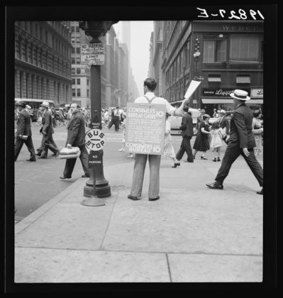 Dorothea Lange Street hawker selling Consumer's Bureau Guide