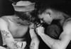 la guerra totale mostra milano tattooed_sailor_aboard_the_USS_New_Jersey_NARA