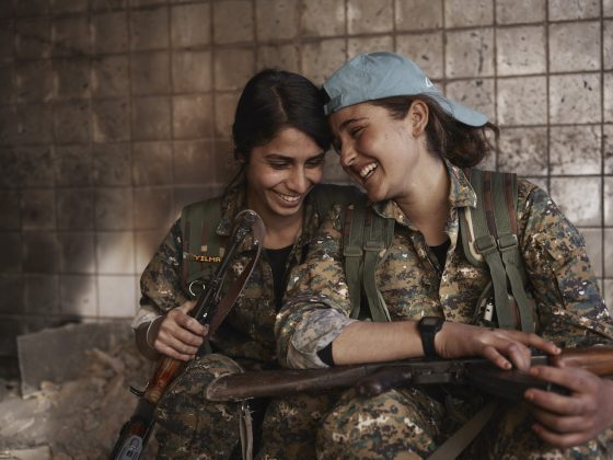 Joey Silava and Berivan share a laugh in an abandoned ISIS base